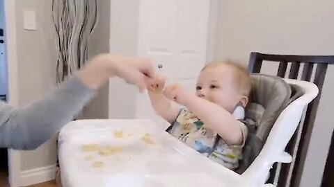 Mom fist bumping with baby causes hilarious giggle fit