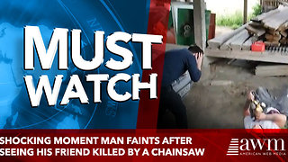 Shocking moment man FAINTS after seeing his friend killed by a CHAINSAW - Video