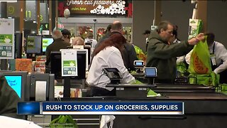Long lines and bare shelves as people stock up at area grocery stores