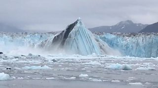 Incredibly Large Glacier Calving Caught On Camera - Video