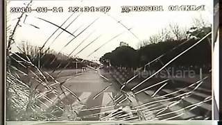 Dash-cam video shows bus hitting woman who abruptly exited car - Video