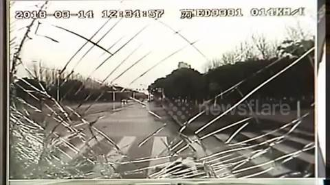 Dash-cam video shows bus hitting woman who abruptly exited car