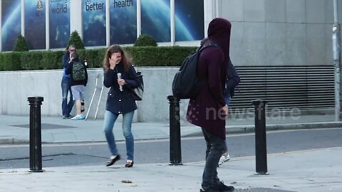 Ireland pedestrians jump and scream as they become victims of giant spider prank