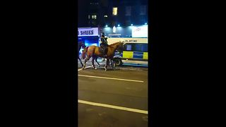 Riot police deployed in Dalston, London during violent protest - Video