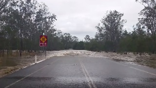 Swollen River Makes Waves Across Queensland Road - Video