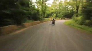 Skateboarder Rides Downhill at Insane Speed - Video