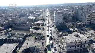 Activist Drone Footage Shows Initial Convoy Leaving Besieged Aleppo - Video