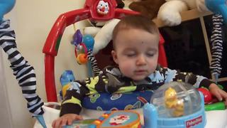 Exhausted baby jumps himself to sleep