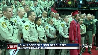 Slain Metro officer's son graduates high school with support of department