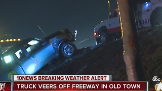 Truck veers off freeway in Old Town - Video