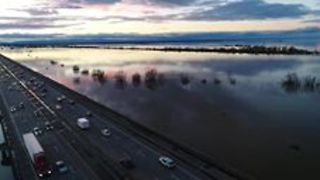 Drone Footage Shows Inundated Sacramento Flood Plain at Sunset - Video
