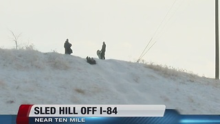 Sledding hill off I-84 grows in popularity - Video