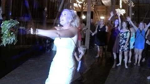 Wedding hero saves the moment bouquet toss goes wrong