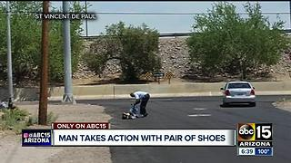 Good Samaritan gives homeless man shoes in scorching heat - Video