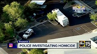 Phoenix police investigating after man found dead behind building - Video