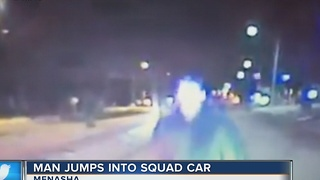 Menasha man arrested after jumping on police car - Video