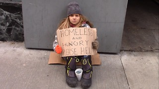 Young Homeless Girl Sits Alone Begging For Help. Pay Close Attention To Woman In Red Plaid - Video