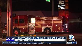 Fire investigated at West Palm Beach gas station - Video