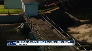 three people escape Neenah dam when boat gets stuck - Video