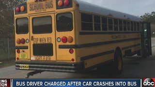 Bus driver charged with DUI after car crashes into bus - Video