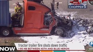 Tractor trailer fire shuts down traffic - Video