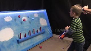 Father builds floating ball Nerf shooting gallery for his children - Video