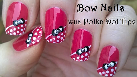 Pretty bow nail art design with dot nail tips