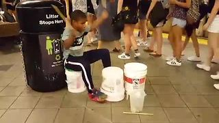 Talented Kid Entertains Subway Commuters With His Buckets