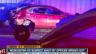 Carjacking and pursuit ends with one suspect shot, mother of suspect wants answers - Video