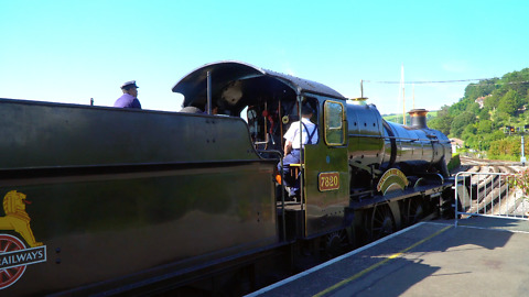 Steam train departs station