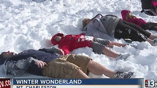Families have fun in snow on Mount Charleston - Video