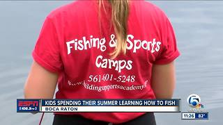 Kids using summer to learn how to catch fish - Video