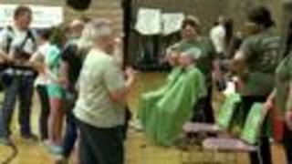 Local kids go bald to conquer cancer - Video
