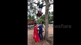 Photographer hangs upside down for perfect wedding shot - Video