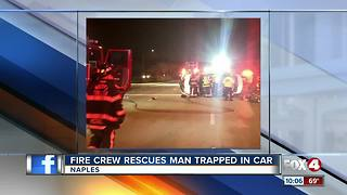 Fire Crews Rescues Man Trapped in Car - Video