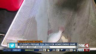 Students prepare fish sale for Island Coast HS homecoming football game