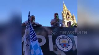 Pep Guardiola chucks beer to fan during Manchester City parade - Video