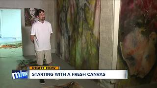 Artist opens gallery in building he tried to rob - Video