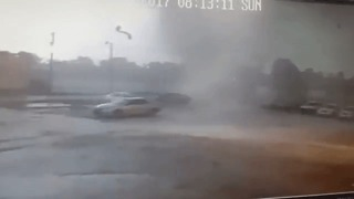 Tornado Flips Car at Lafayette Repair Shop - Video
