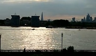 Police Pursue Jetskis Along the River Thames - Video