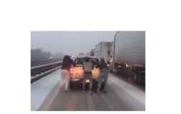 People Cling to Moving Pickup Truck and 'Ski' on Frozen Interstate in Louisiana - Video