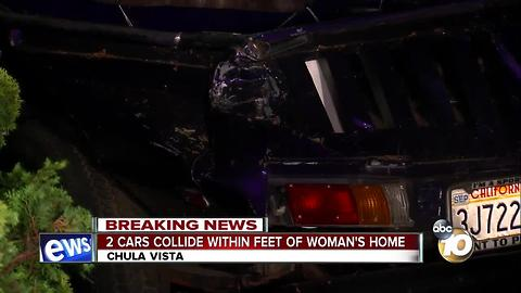2 cars collide within feet of woman's home