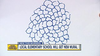 Cleveland Elementary students painting street mural to slow traffic, create a sense of community