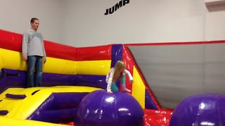 Hilarious Dad Fails Gloriously At Bouncy Obstacle Course - Video