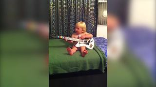 Baby Boy Loves Playing The Guitar - Video