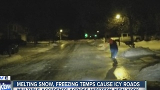 Residential streets covered in slick sheets of ice - Video