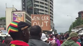 'Wenger Out' Sign Spotted Amid Protests Against Robert Mugabe