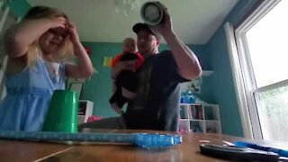 Girl is impressed by dad's magic trick