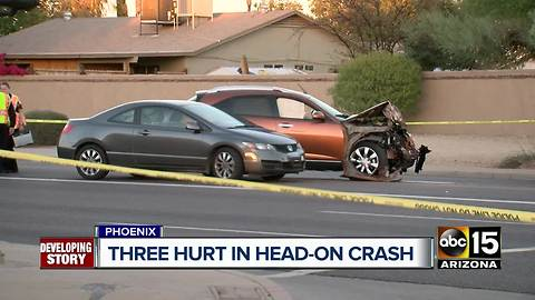 Man, woman hospitalized after head-on crash