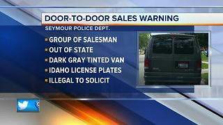 Police warn residents about suspicious door to door salesmen - Video